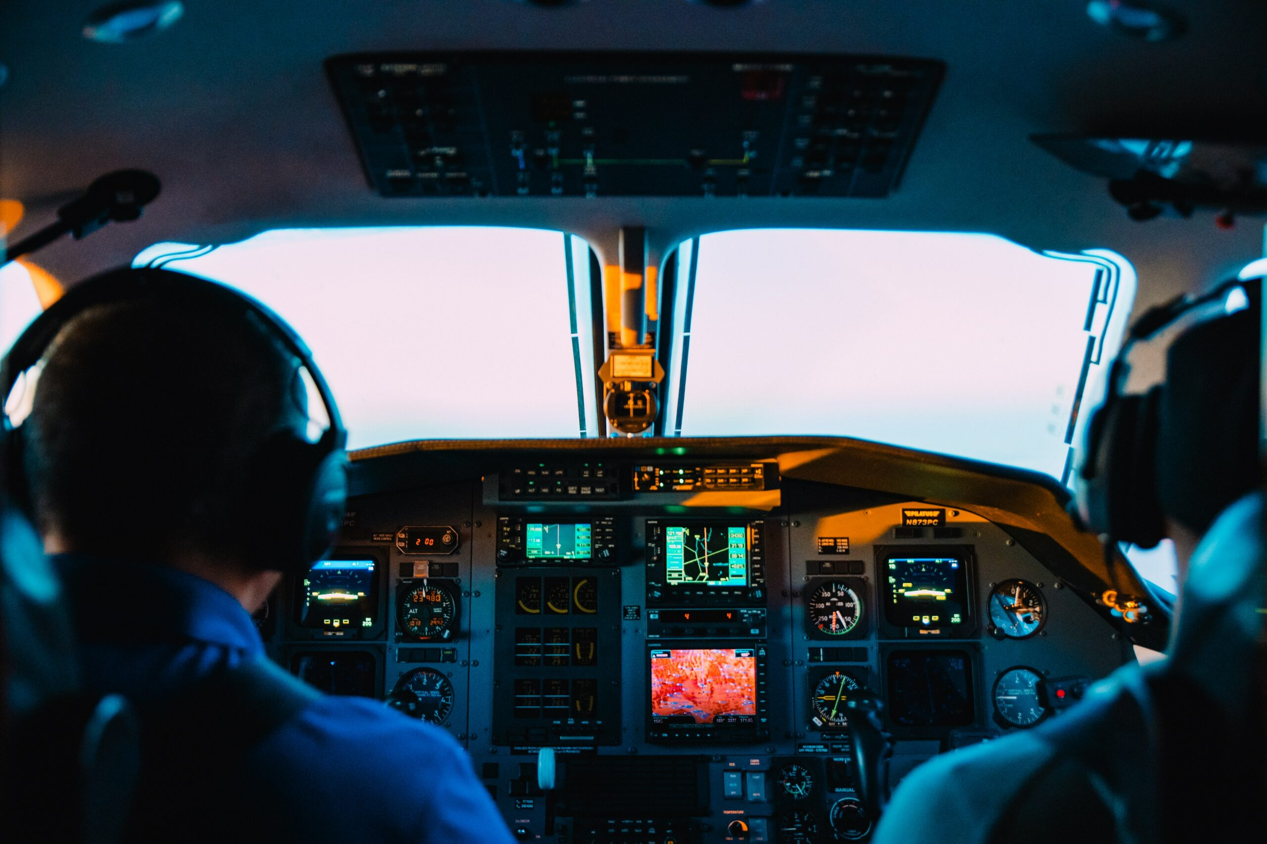 pilots in cockpit flying